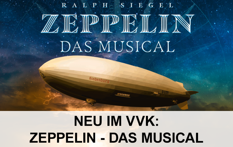 Ein Zeppelin mit der Aufschrift Hindenburg vor einem beleuchteten Himmel